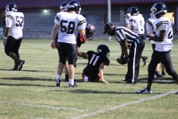Injured player on the field. #11 Roddi Morris suffers from a hurt leg on the field.
