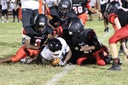 Hartsville defensive players tackling Camden player.