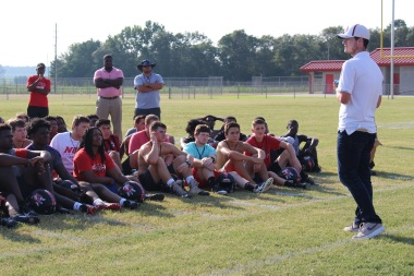 Hartsville Church of God youth pastor Austin Dye speaking to the players.