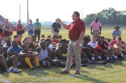 """Pastor John """"Bootsie"""" Griggs holding up the holy water used to bless the helmets. Bootsie then explained to the football players it is your faith that blesses you, not the holy water."""