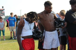 Senior Varsity football players JD Pendegrass and Lacion Josey during prayer.